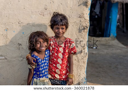 RAXAUL, INDIA - NOV 12: Unidentified Indian girls on Nov 12, 2013 in Raxaul, Bihar state, India. Bihar is one of the poorest states in India. The per capita income is about 300 dollars. - stock photo