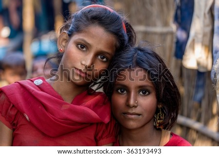 RAXAUL, INDIA - NOV 12: Unidentified Indian girls on Nov 12, 2013 in Raxaul, Bihar state, India. Bihar is one of the poorest states in India. The per capita income is about 300 dollars.