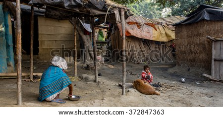 RAXAUL, INDIA - NOV 12: Unidentified Indian people on Nov 12, 2013 in Raxaul, Bihar state, India. Bihar is one of the poorest states in India. The per capita income is about 300 dollars.