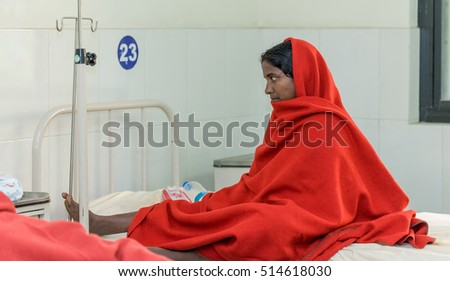 RAXAUL, INDIA - NOV 13: Unidentified Indian woman in a local hospital on November 13, 2013 in Raxaul, Bihar, India. Bihar is one of the poorest states in India.