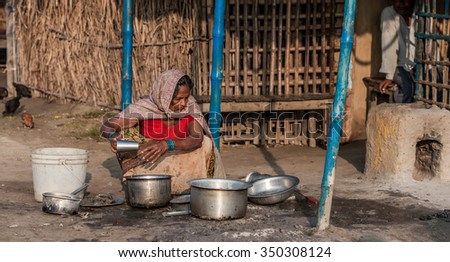 RAXAUL, INDIA - NOV 10: Unidentified Indian woman on Nov 10, 2013 in Raxaul, Bihar state, India. Bihar is one of the poorest states in India. The per capita income is about 300 dollars. - stock photo