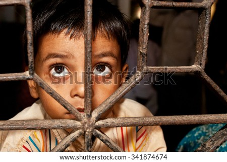 RAXAUL, INDIA - OCT 24: Unidentified Indian boy in a local hospital on Oct 24, 2011 in Raxaul, Bihar state, India. Bihar is one of the poorest states in India. The per capita income is 300 dollars. - stock photo