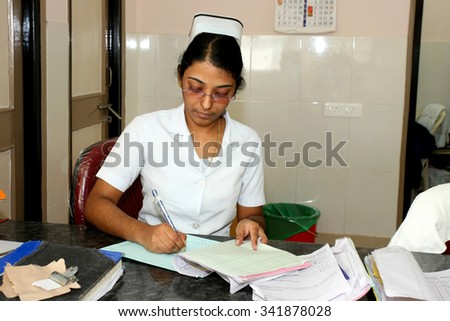 RAXAUL, INDIA - OCT 21: Unidentified Indian nurse in a local hospital on Oct 21, 2011 in Raxaul, Bihar, India. Bihar is one of the poorest states in India. The per capita income is 300 dollars. - stock photo