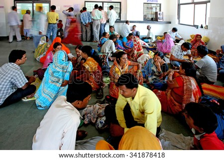 RAXAUL, INDIA - OCT 24: Unidentified Indian people in a local hospital on Oct 24, 2011 in Raxaul, Bihar state, India. Bihar is one of the poorest states in India. The per capita income is 300 dollars. - stock photo
