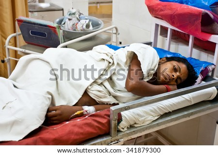 RAXAUL, INDIA - OCT 22: Unidentified Indian woman in a local hospital on Oct 22, 2011 in Raxaul, Bihar state, India. Bihar is one of the poorest states in India. The per capita income is 300 dollars.