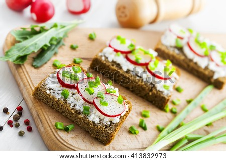 Ray bread with soft cream cheese and radish. Delicious vegetarian food.