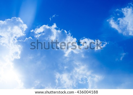 Ray of light shining through clouds and sky - stock photo