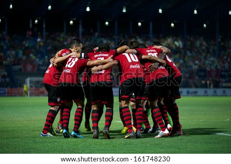 RAYONG,THAILAND-28 AUGUST:Players of Muangthong United celebrates after scoring Thai FA Cup between Muangthong United and PTT Rayong F.C.at PTT Stadium on Aug 28,2013 in Rayong,Thailand - stock photo