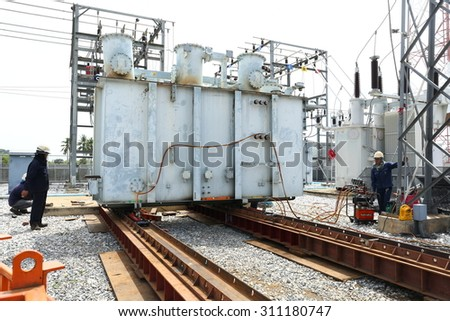 RAYONG -THAILAND - AUGUST 8 :Workers are preparing the process of moving the old transformers are large, high-voltage station. August 8, 2015 in Rayong province, Thailand