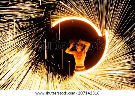 Rayong, Thailand - February, 22, 2013: amazing Fire Show on the beach at night on February, 22, 2013 at Samed Island, Rayong, Thailand. - stock photo