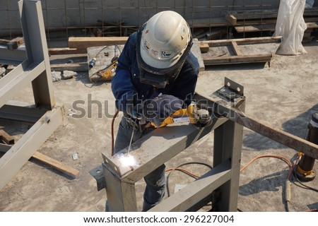 Rayong,Thailand-February 9, 2015: Unidentified Asian welder is welding a steel structure in construction project in Rayong, Thailand.