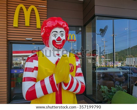 RAYONG, THAILAND - JANUARY 02 , 2016: Ronald McDonald character at McDonald's thru drive restaurant in esso gas station highway road number36 on January 02, 2016 in Rayong , Thailand - stock photo