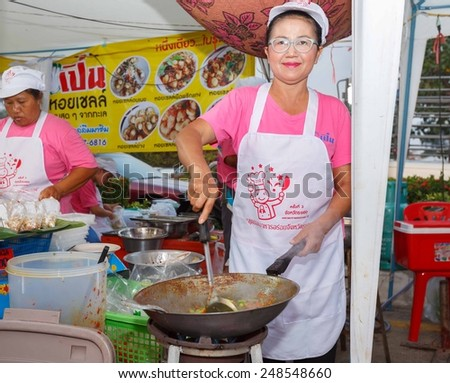 RAYONG, THAILAND -  JANUARY 23 : Unidentified Thai people sell food at night market walk street on January 23,2015 in Rayong, Thailand