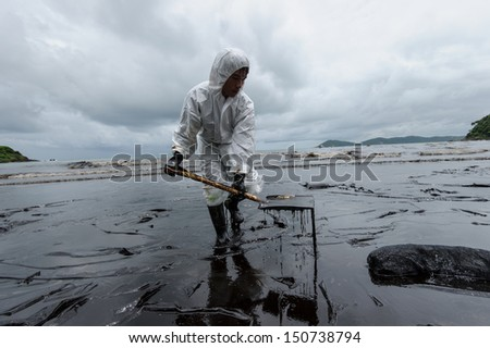 RAYONG, THAILAND - JULY 31: cleaning operations of crude oil due to spill accident on Ao Prao Beach in Samet island on July 31, 2013 in Rayong,Thailand