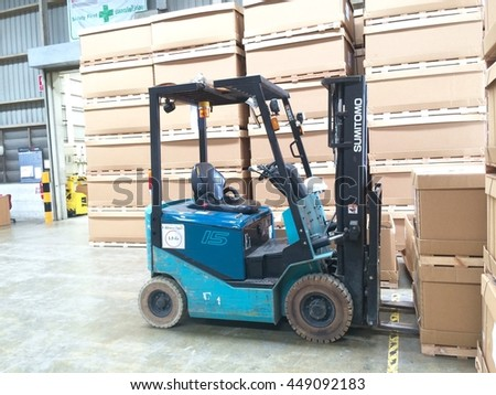 Rayong Thailand , July 08 - 2016 : Lift truck in factory warehouse for chipping material supply customer in Thailand.
