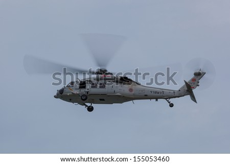 RAYONG,THAILAND-July 31:The government use MH-60 Seahawk helicopter to see the progress of crude oil cleaning on oil spill accident on Ao Prao Beach at Samet island on July 31,2013 in Rayong,Thailand
