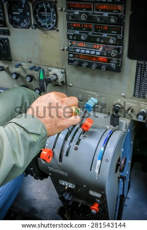 RAYONG , THAILAND- MAR 28, 2015: Pilot in a cabin of Cessna 208 Caravan no.1918 of KASET, Bureau of Royal Rainmaking and Agricultural Aviation. U-TAPAO Airport, Rayong - stock photo