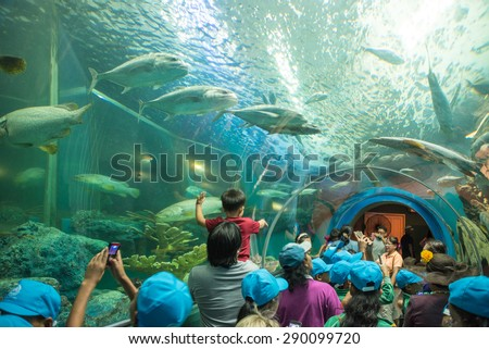 Rayong, THAILAND - MARCH 20:  Tourists at the Aquatic tunnel in the Rayong Aquarium, Thailand, on March 20 - stock photo