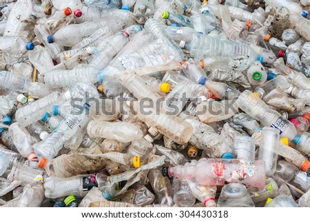 RAYONG, THAILAND - MAY 29, 2014 : Plastic bottles lie in a heap at an undisclosed recycling facility circa 2014 in Rayong. The plastic is gathered to be recycled. - stock photo