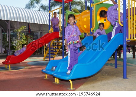 RAYONG, THAILAND - MAY 30: Unidentified children are happy to play at the playground on May 30,2014 in Rayong, Thailand.