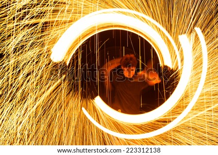 Rayong, Thailand - October, 13, 2014 : steel wool spinning in amazing fire show on the beach at night on October, 13, 2014 at Samed Island, Rayong, Thailand. - stock photo