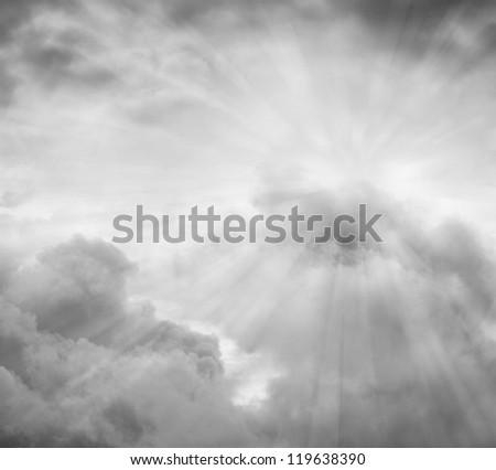 Rays of light in grey sky - stock photo