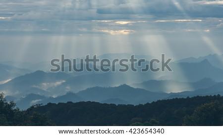 Rays of light shining down // Horizontal - stock photo