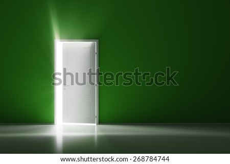 Rays of light through the open white door on green wall - stock photo