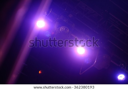 rays of spotlights at a concert