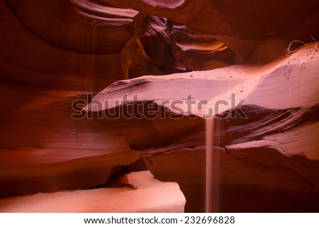 Rays of sunlight creating an array of colors within Antelope Canyon - stock photo