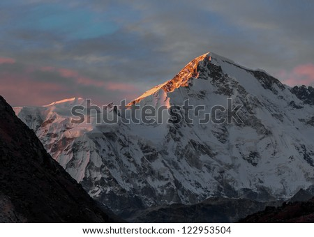 Rays of sunset on the tops of the mountains - Gokyo region, Nepal, Himalayas - stock photo