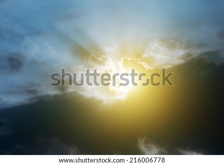 Rays of the sun from behind the clouds.