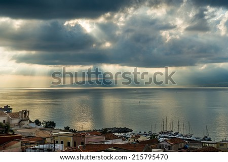 Rays of the sun is passing through the dark clouds seascape - stock photo