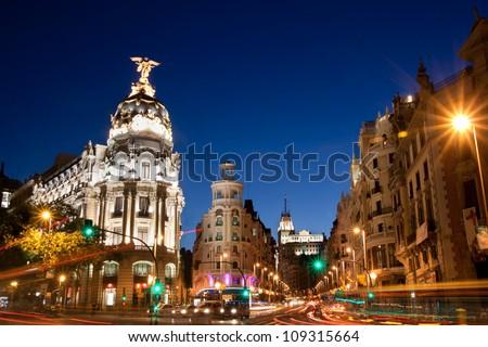 Rays of traffic lights on Gran via street, main shopping street in Madrid at night. Spain, Europe. - stock photo