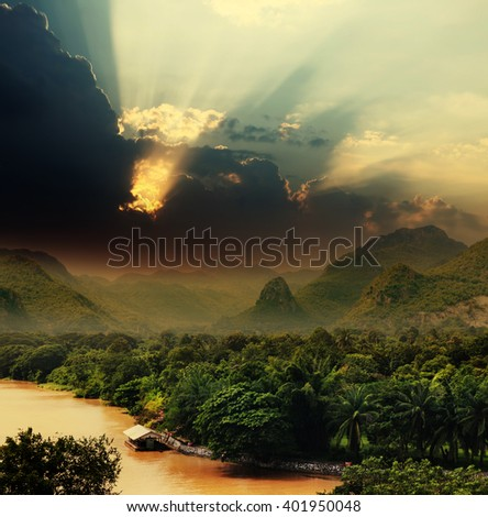 rays on sky over Khwae Yai river which is in Thailand