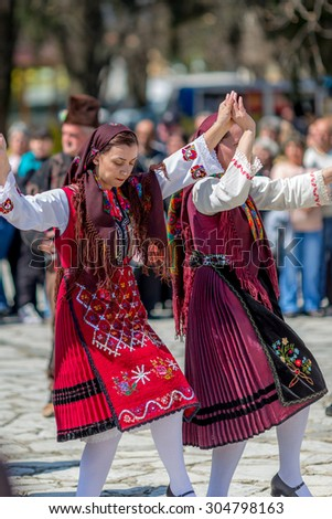 "RAZLOG, BULGARIA - APRIL 13, 2015: Female Bulgarian folklore dancers during the traditional folklore festival ""1000 national costumes"""