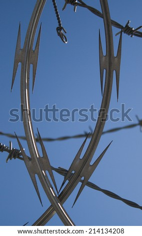 Razor and Barbed Wire - stock photo