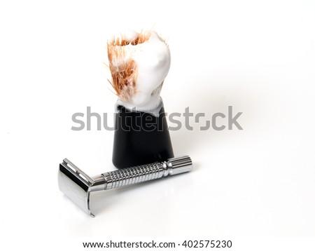 razor and shaving brush on a white background - stock photo