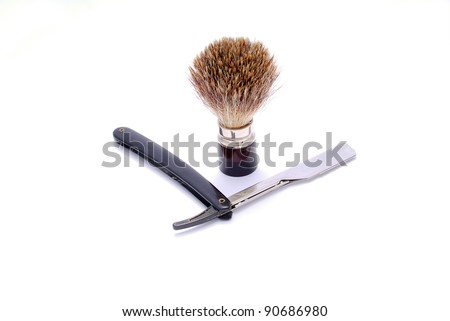 razor and shaving brush on a white background - stock photo