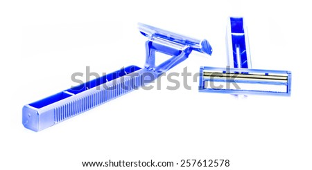 razor blade shows the front and back of a blue handle shaving accessory. - stock photo