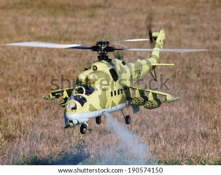 RC Model Hind Scale Model Helicopter Flying in Flight - stock photo