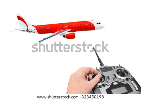 RC plane and radio remote control isolated on white background - stock photo