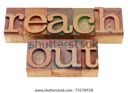 reach out phrase in vintage wood letterpress printing blocks, isolated on white