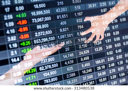 Reaching a hand.on stock market chart background - stock photo
