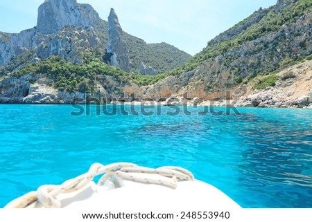 reaching Cala Goloritze on a white boat. Shot in Sardinia, Italy - stock photo