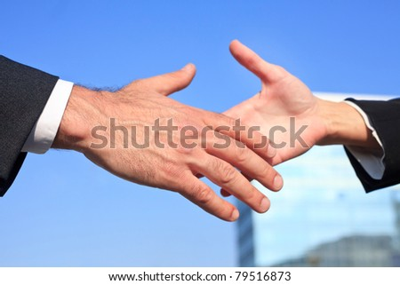 reaching for a handshake - stock photo