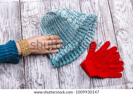 Reaching for her knit hat.