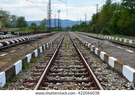 Reaching the horizon straight old railways - stock photo