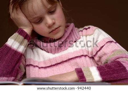 Reading a book 4 Bored or just concentrated? - stock photo