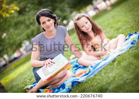 reading a book in the park - stock photo